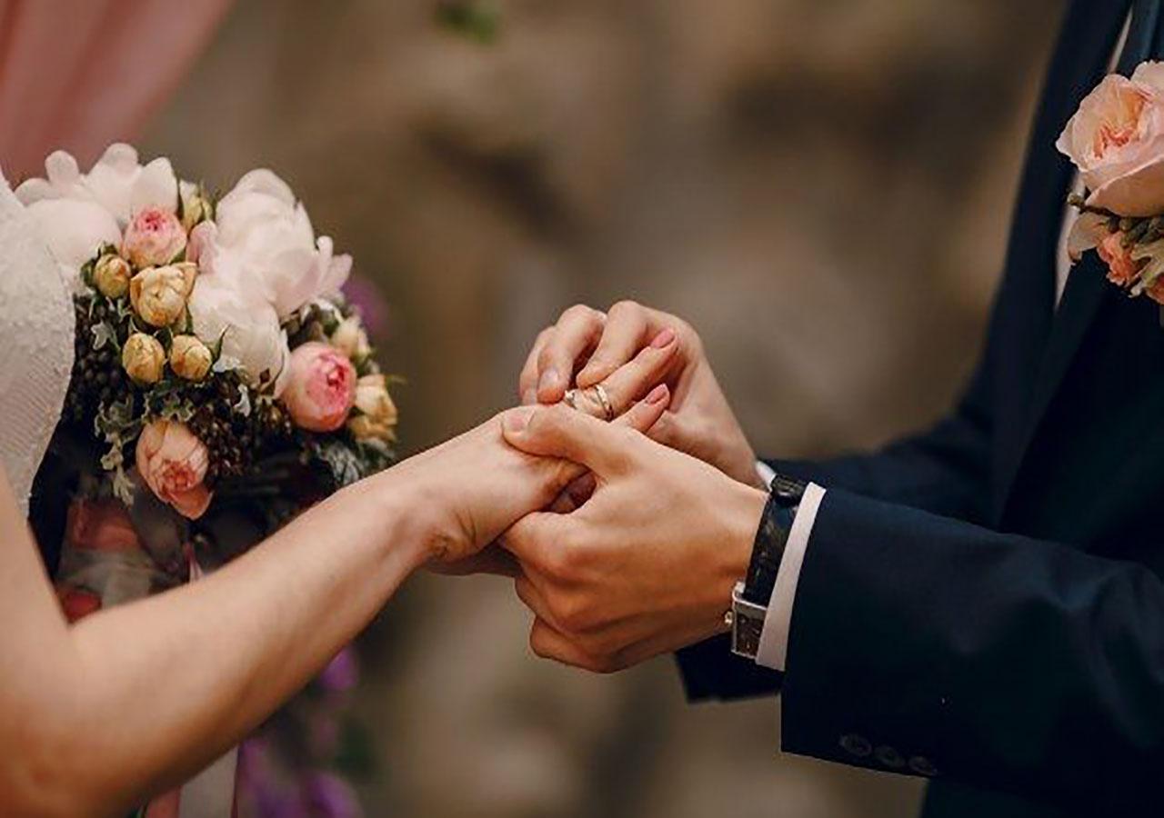 groom-putting-ring-bride-s-finger_1157-338-626